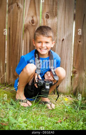 boy holding camera - Stock Image