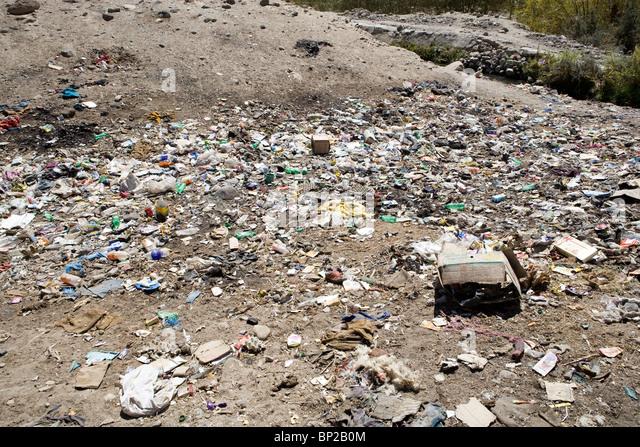 Rubbish dump near the Tibetan settlement in Choglamsar, few Km from Leh In Ladakh. - Stock Image