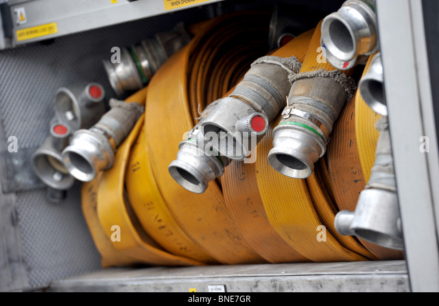 Hoses on a fire truck in Brighton, Sussex, UK. - Stock Image