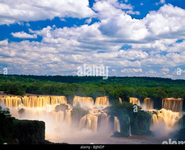 Afternoon clouds at Iguazu Falls, Iguazu Falls National Park, Brazil, huge waterfall complex in Southern Brazil - Stock Image