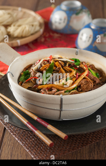 Shanghai beef noodles in a clay pot Chinese Food - Stock Image