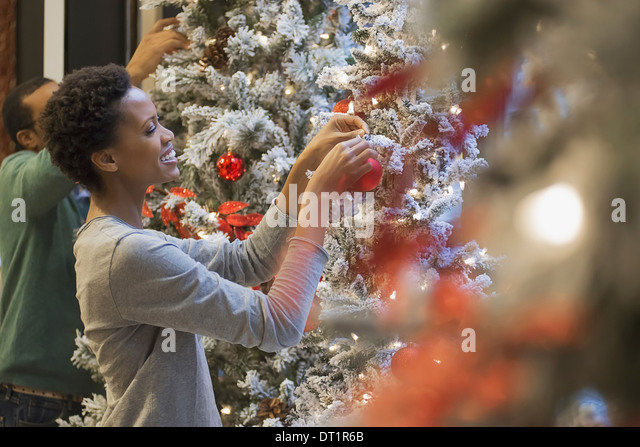Couple at home decorating for Holidays - Stock Image
