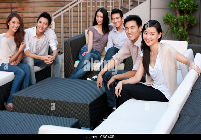 Friends Relaxing at an Outdoor Bar - Stock Image
