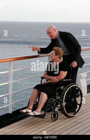 Sint Maarten Caribbean Sea Holland America Line ms Noordam Observation Deck senior couple wheelchair - Stock Image