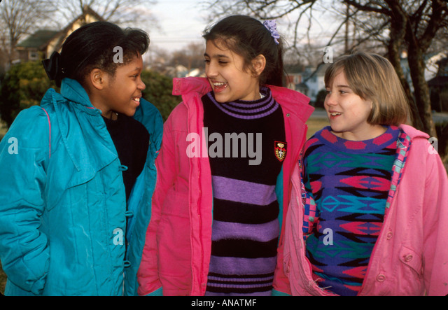 New Jersey Teaneck adolescent girls Black Asian female smile - Stock Image