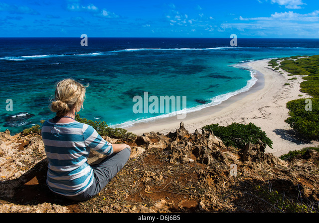 Tourist enjoying the beautiful scenery of Barbuda, Antigua and Barbuda, West Indies, Caribbean, Central America - Stock Image