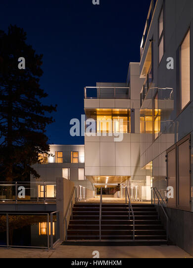 Night view of exterior showing stairway and walkway. Dunluce Apartments, Ballsbridge, Ireland. Architect: Derek - Stock-Bilder