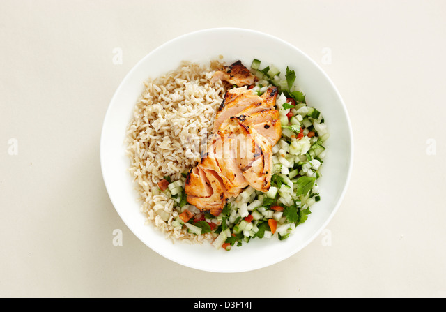 Salmon fennel cucumber salad brown rice - Stock Image