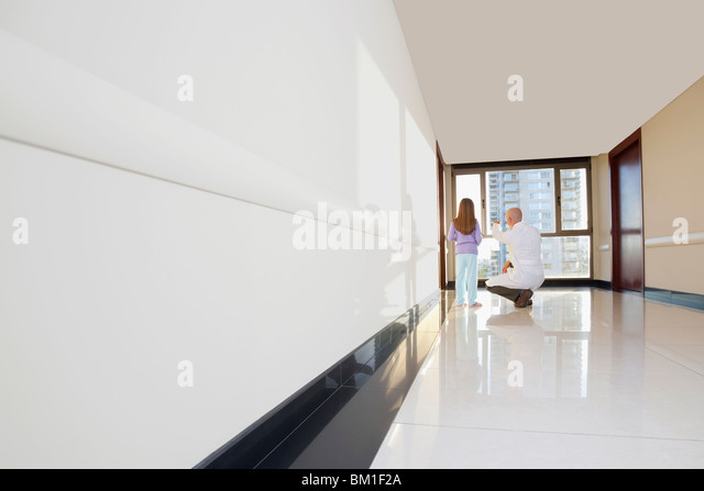 Doctor with a girl in the corridor - Stock Image