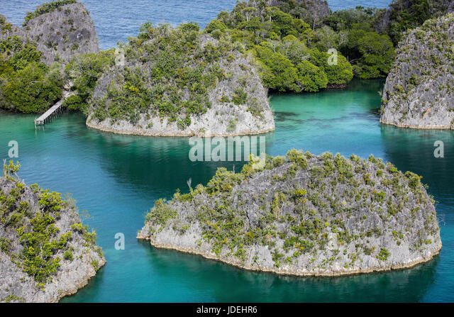 Rock Islands of Raja Ampat, West Papua, Indonesia - Stock Image