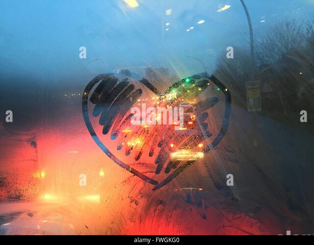 Close-Up Of Heart Shape On Condensed Window - Stock-Bilder