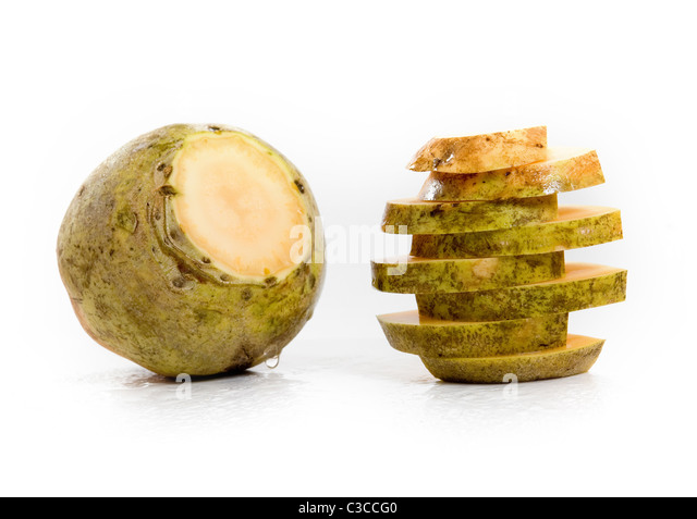 Yellow Turnip and some freshly cut slices of it - Stock Image