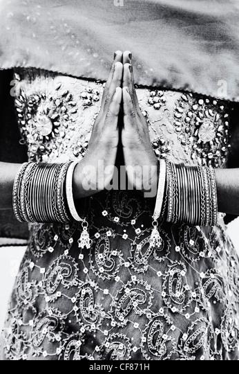 Indian girl namaste prayer hands. Monochrome - Stock Image