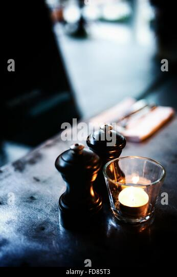 Salt And Pepper Shakers With Candle - Stock Image
