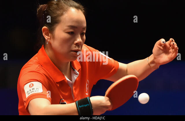 Doha, Qatar. 10th Dec, 2016. Tie Yana from Hong Kong of China returns a shot during the women's singles quarterfinal - Stock-Bilder