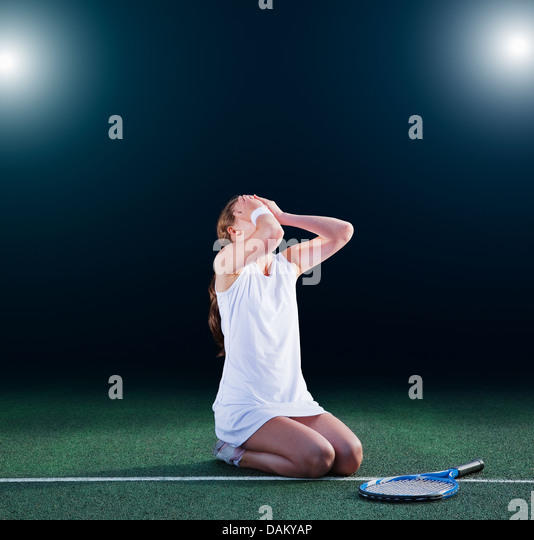 Tennis player crying on court - Stock Image
