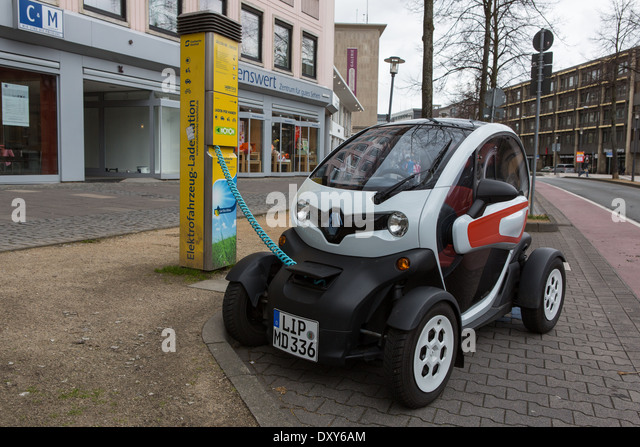 An electric car having its battery re-charged - Stock Image
