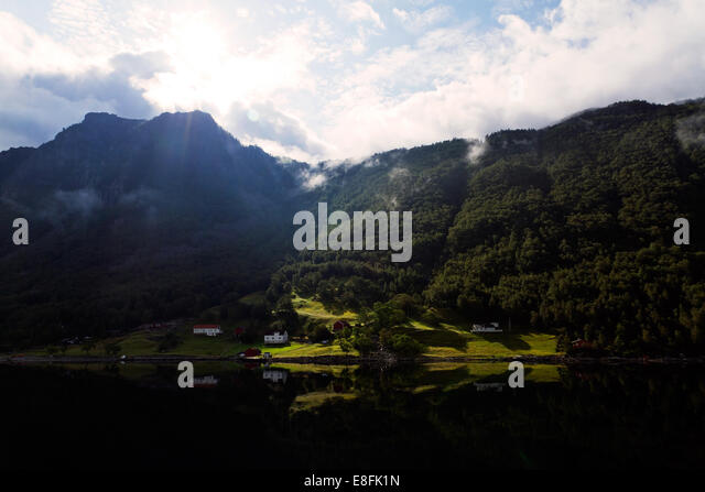 Summersun shining on houses - Stock Image