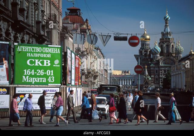 Russia former Soviet Union St. Petersburg Nevsky Prospekt residents billboards Church on Savior's Blood to right - Stock Image
