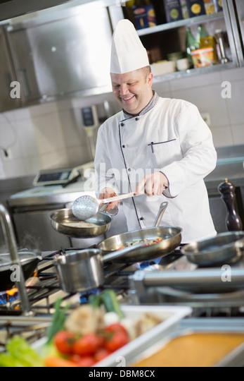 Cook In Commercial Kitchen - Stock-Bilder