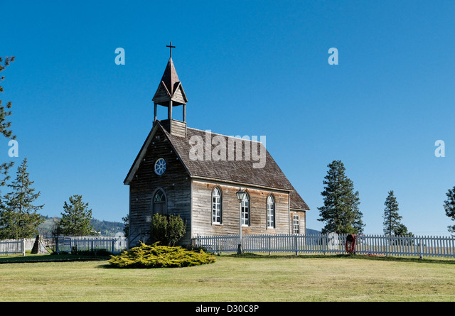 The rustic heritage St. Anne's Church at the historic O'Keefe Ranch near Vernon, British Columbia, Canada. - Stock Image