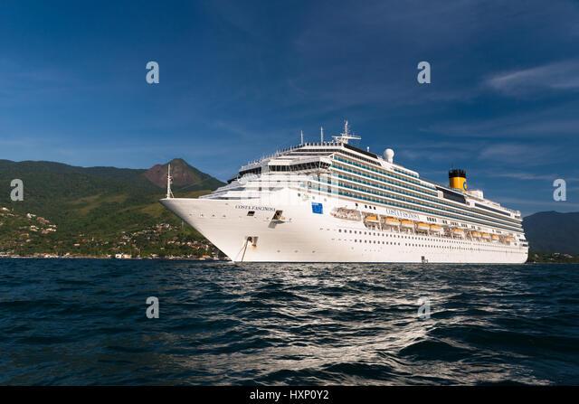 Costa Fascinosa cruise ship anchored off Ilhabela - Stock Image