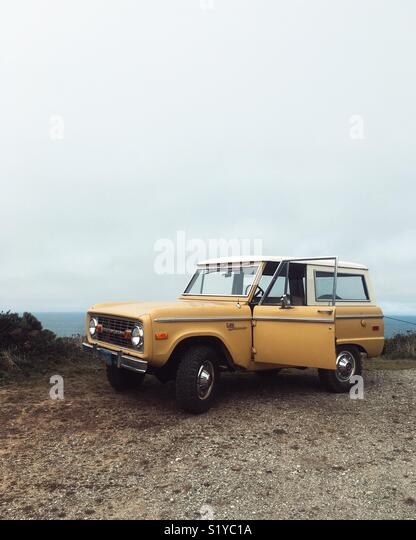 A vintage Ford Bronco at the California Coast. - Stock Image