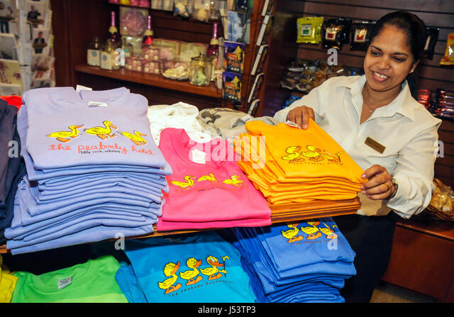 Little Rock Arkansas The Peabody Little Rock hotel gift shop Asian woman tee t shirts logo merchandise sell sales - Stock Image