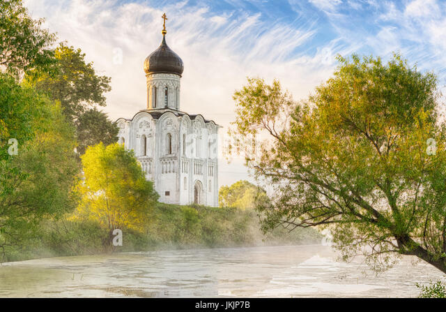 Church of the Intercession on the Nerl in morning fog in Bogolubovo, Vladimir oblast, Russia - Stock Image