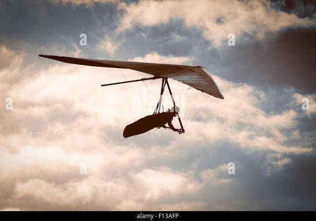 Hang glider at sunset - Stock Image