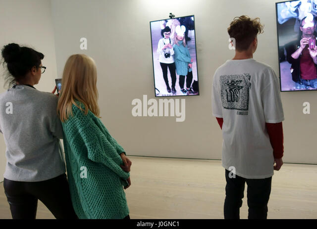 Visitors at Saatchi Gallery exhibition on the art of the selfie, London - Stock Image