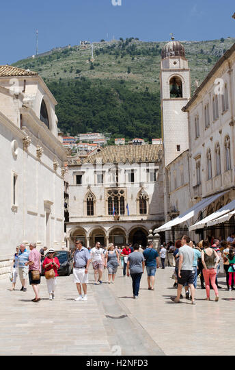 Dubrovnik Croatia  Tourists in the old town of Dubrovnik walk towards the Sponza Palace - Stock Image