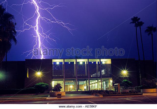 Huge lightning bolt strikes down behind the Ina Gittings Building on the University of Arizona Campus Tucson Arizona - Stock Image