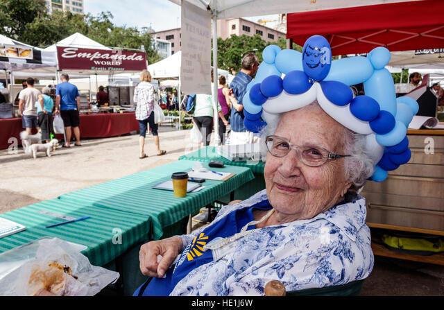 St. Saint Petersburg Florida Saturday Morning Market vendors stalls shopping food artisan gourmet farmers senior - Stock Image