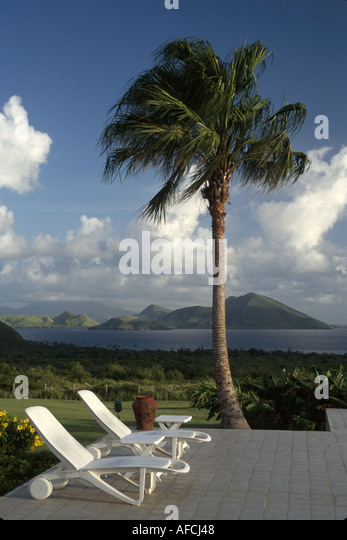 West Indies Nevis The Narrows Mt. Nevis Hotel grounds swimming pool deck St. Kitts Southeast Peninsula view - Stock Image
