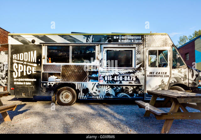 The Riddim N Spice food truck parked in the 5 Points district in trendy East Nashville, TN serves up healthy Caribbean - Stock Image