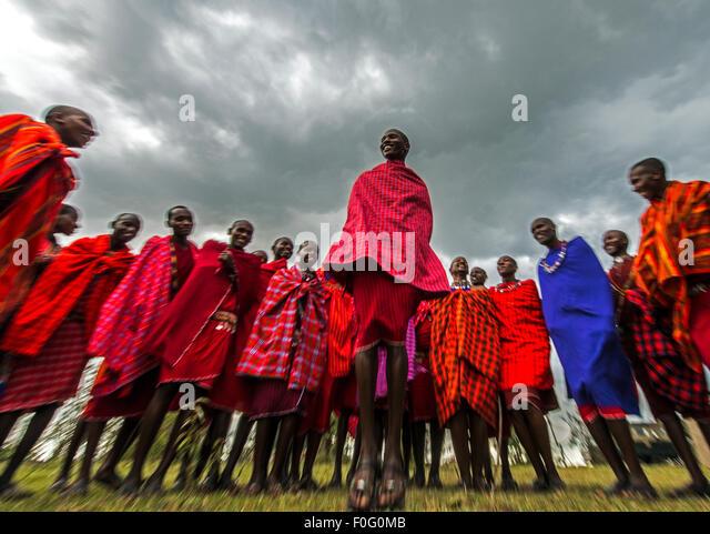 Traditional jumping dance Maasai people Mara Naboisho conservancy Kenya Africa - Stock-Bilder
