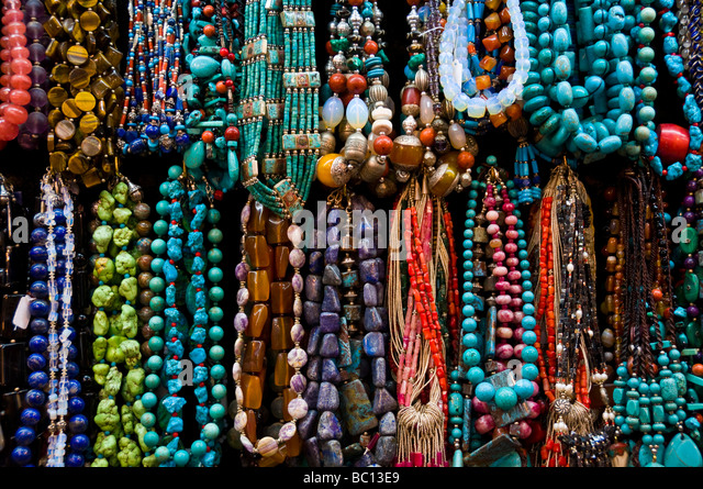 Traditional handicrafts on display in stores Mutrah Souk Muscat Oman - Stock Image