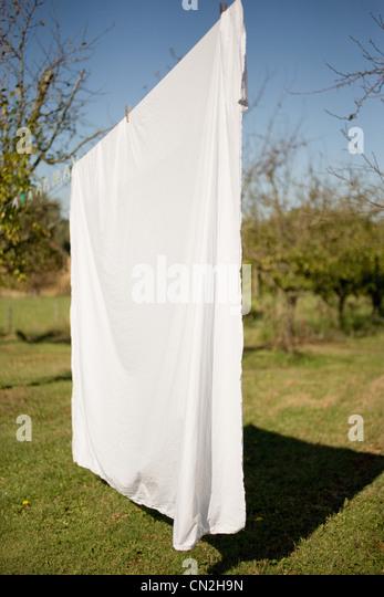 Sheet drying on washing line - Stock-Bilder