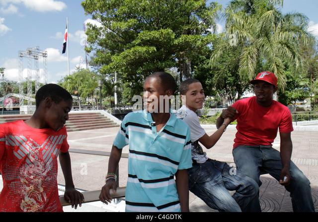 Santo Domingo Dominican Republic Ciudad Colonial Parque Independencia park Hispanic Black mixed race student boy - Stock Image