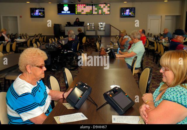 Nevada Las Vegas Downtown Plaza Hotel & Casino bingo gambling gamblers game luck woman senior electronic card - Stock Image