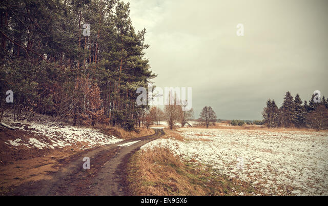 Retro toned peaceful rural landscape with vignette effect. - Stock Image