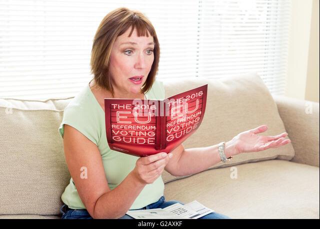 woman deciding on the EU referendum - Stock Image