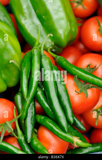 Close up shot of home grown greenhouse harvest of Sweet peppers chili peppers and tomatoes UK August - Stock Image