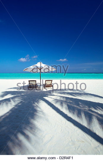 Deck chairs and tropical beach, Maldives, Indian Ocean, Asia - Stock Image