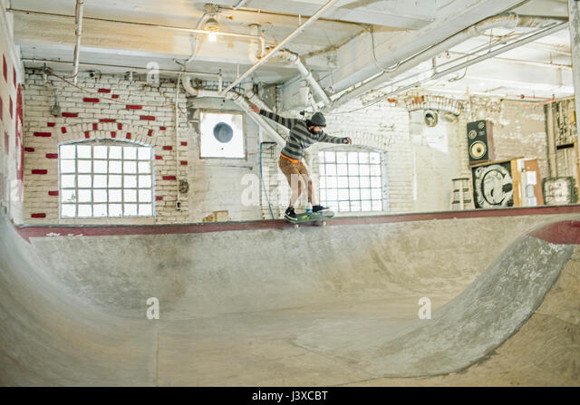 Young man skateboarding. - Stock Image