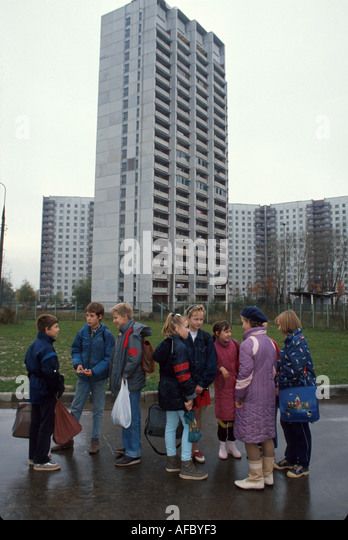 Russia former Soviet Union Moscow students gather after school residential apartments beyond - Stock Image