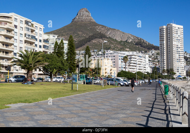 South Africa, Cape Town. Sea Point Promenade. Lion's Head in the Background. - Stock Image