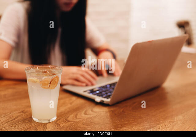 Woman with laptop in cafe - Stock-Bilder