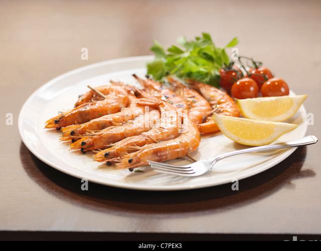 Plate of prawns at restaurant - Stock Image